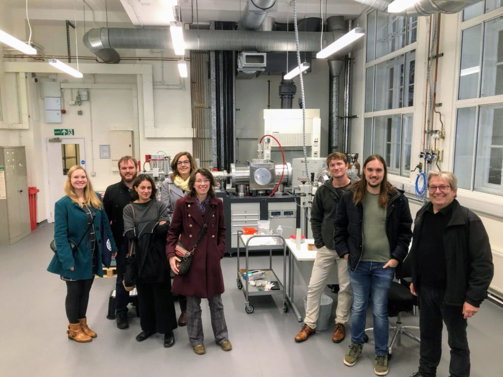 Rural Riches team posing with the Oxford Radiocarbon Accelerator Unit of the Research Laboratory for Archaeology and the History of Art (RLAHA)